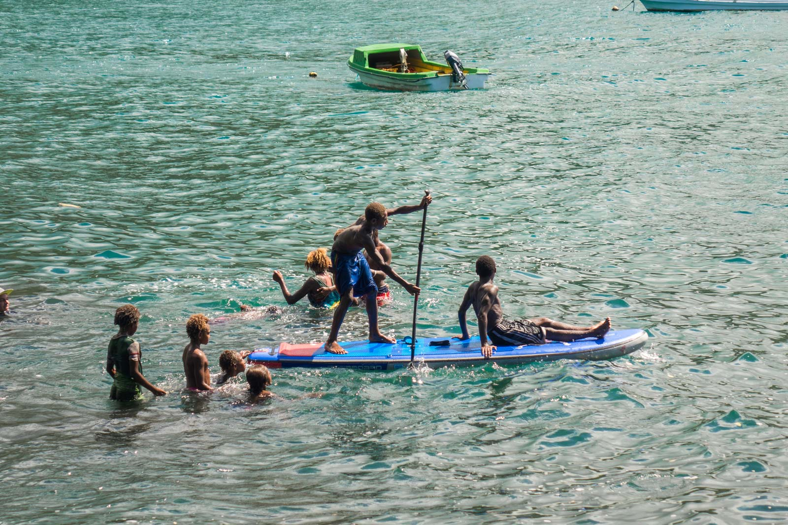 Starboard-SUP-Bart-de-Zwart-Trevor-Tunnington-Explore-the-Islands-of-Vanuatu-by-Stand-Up-Paddleboard-kids-on-sup