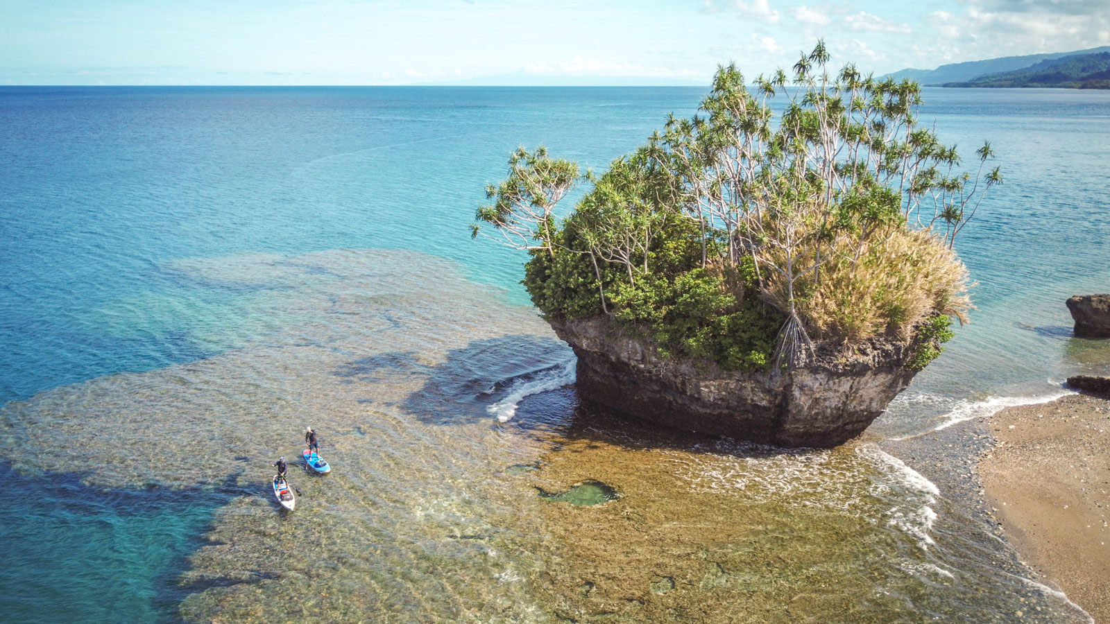 Starboard-SUP-Bart-de-Zwart-Trevor-Tunnington-Explore-the-Islands-of-Vanuatu-by-Stand-Up-Paddleboard-reef-and-island