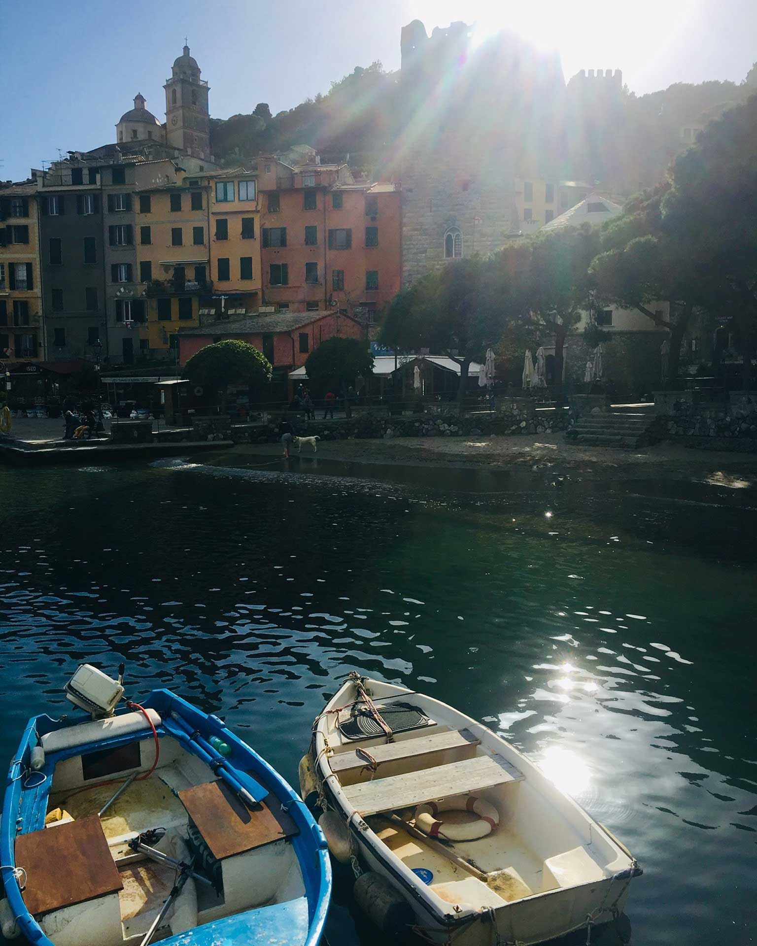 The-Three-Day-Effect-in-Italy-with-Linzi-Hawkin-Cinque-Terre-Stand-Up-Paddleboarding-adventure-boats-in-dock