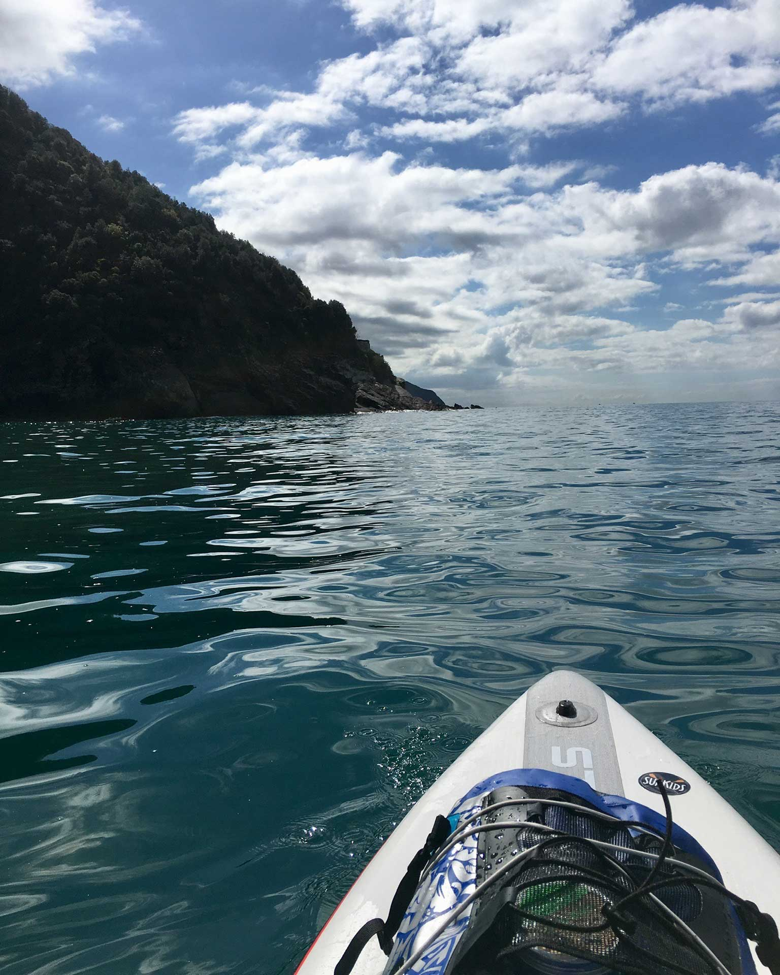 The-Three-Day-Effect-in-Italy-with-Linzi-Hawkin-Cinque-Terre-Stand-Up-Paddleboarding-adventure-dry-bag-on-touring-zen-inflatable